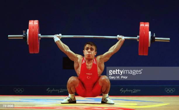 Halil Mutlu of Turkey lifts weights while on his way to winning the Gold Medal in the 56 kilogram Snatch Weighlifting event at the Sydney 2000...
