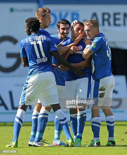 Halil Savran of Rostock jubilates with team mates after scoring the first goal during the third league match between FC Hansa Rostock and Borussia...