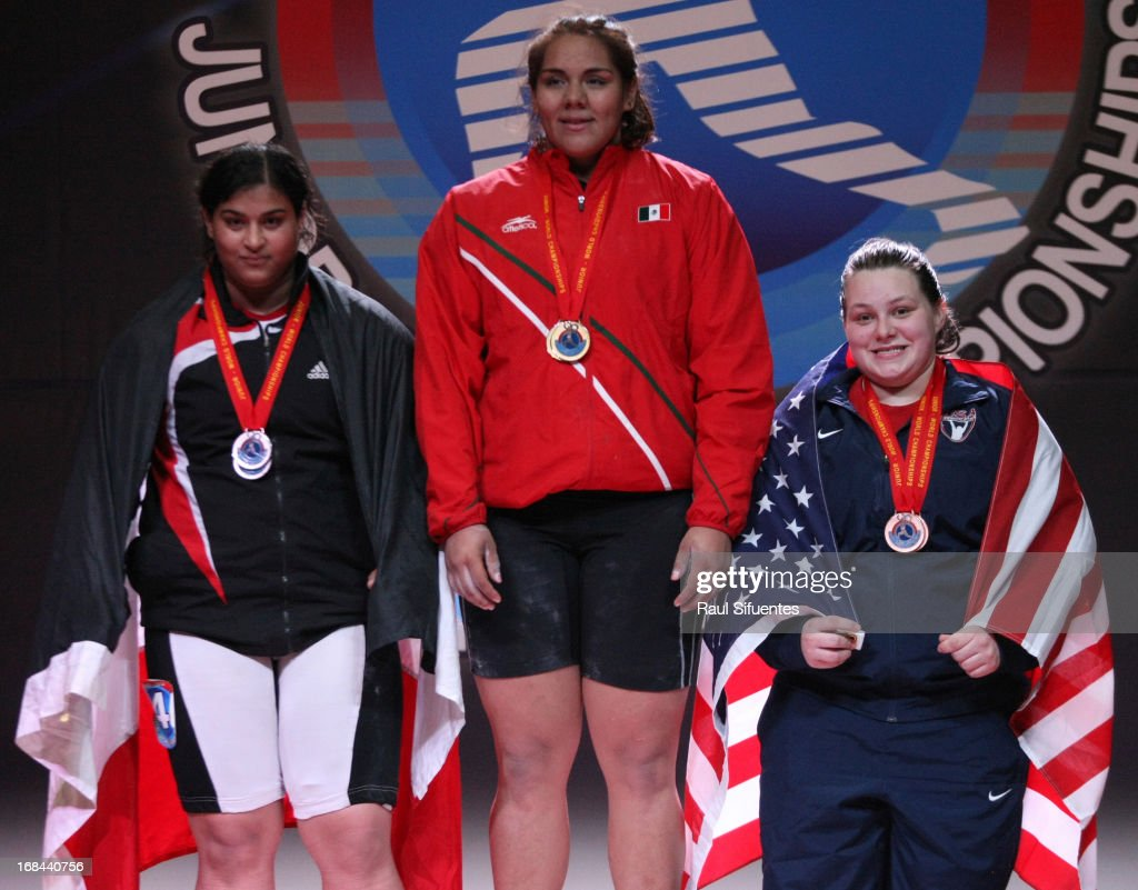 Halima Abdel Aziem of Egypt A, Junior World Champion Gladis Bueno of Mexico and Marissa Eileen Klingseis of US in the podium of Women's +75kg during day six of the 2013 Junior Weightlifting World Championship at Maria Angola Convention Center on May 09, 2013 in Lima, Peru.