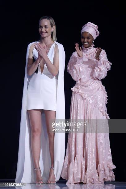 Halima Aden and Amber Valletta present the Accessories Designer of the Year Award on stage during The Fashion Awards 2019 held at Royal Albert Hall...