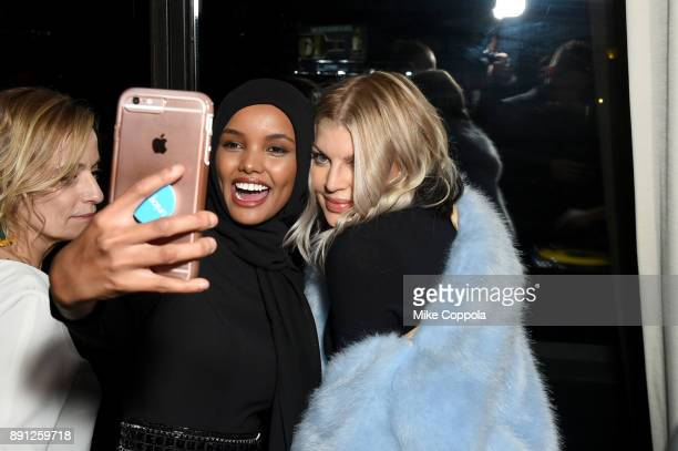 Halima Aden and Fergie attend the CR Fashion Book Celebrating launch of CR Girls 2018 with Technogym at Spring Place on December 12 2017 in New York...
