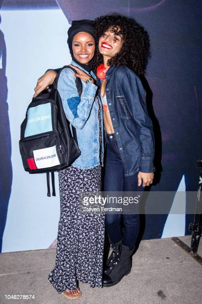Halima Aden and Indya Moore pose backstage during A$AP Rocky's surprise performance for Calvin Klein Jeans X Amazon Fashion Launch NYC Market at...