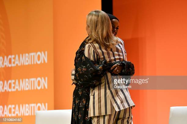 Halima Aden and Tory Burch embrace onstage during the 2020 Embrace Ambition Summit by the Tory Burch Foundation at Jazz at Lincoln Center on March 05...