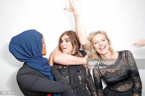 Halima Aden Carine Roitfeld and Eva Herzigova attend The Veuve Clicquot Widow Series By Carine Roitfeld And CR Studio on October 19 2017 in London...