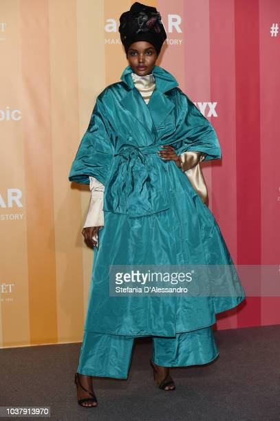 Halima Aden walks the red carpet ahead of amfAR Gala at La Permanente on September 22 2018 in Milan Italy