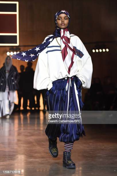 Halima Aden walks the runway at the TommyNow show during London Fashion Week February 2020 at the Tate Modern on February 16, 2020 in London, England.
