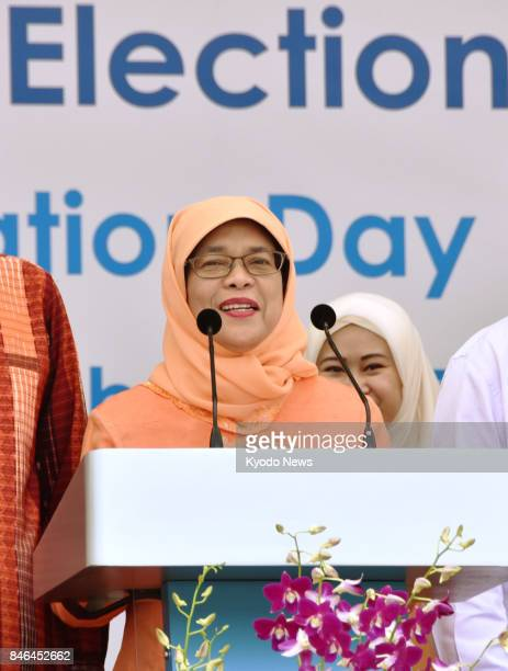 Halimah Yacob Singapore's first female president gives a speech in central Singapore on Sept 13 after winning a controversial nocontest election...