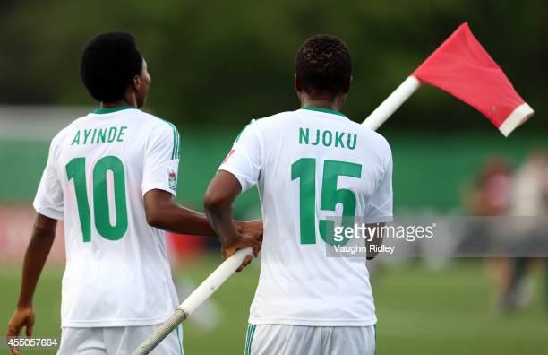 Halimatu Ayinde and Ugo Njoku of Nigeria celebrate victory following the final whistle of the FIFA U20 Women's World Cup Canada 2014 Semi Final match...