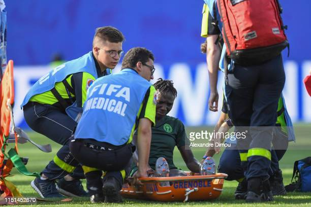 Halimatu Ayinde of Nigeria injured during the Women's World Cup match between Germany and Nigeria at Stade des Alpes on June 22, 2019 in Grenoble,...