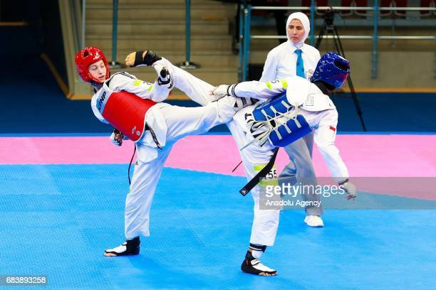 Halinda Mariska of Indonesia and Agris Zeliha of Turkey compete in the Women's 53kg Taekwondo Semfinal during day five of the Baku 2017 4th Islamic...
