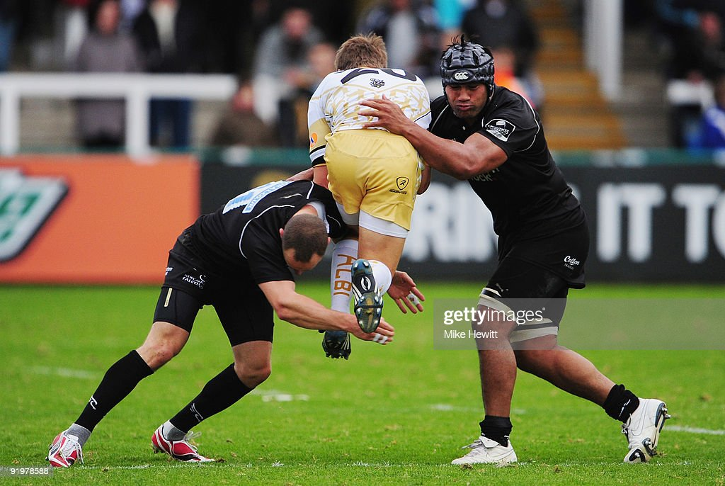 Hall Charlton (L) and Filipo Levi of Newcastle stop Baptiste Hecker of Albi in his tracks during the Amlin Challenge Cup match between Newcastle Falcons and Albi at Kingston Park on October 18, 2009 in Newcastle upon Tyne, England.