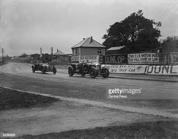 Hall driving a Bentley followed by Italian racing driver Achille Varzi driving an Alfa Romeo during the Ulster Tourist Trophy race