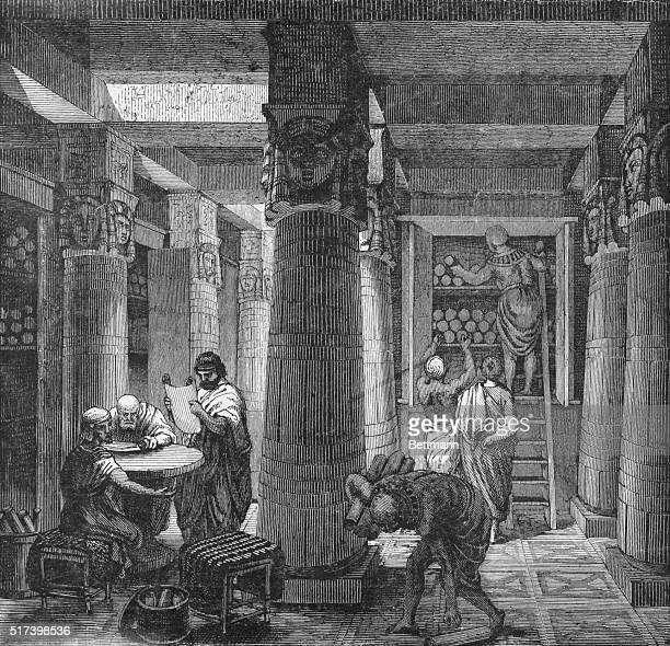 A hall in the Library of Alexandria Egypt Ancient scholars converse while reading the papyrus scrolls Undated illustration
