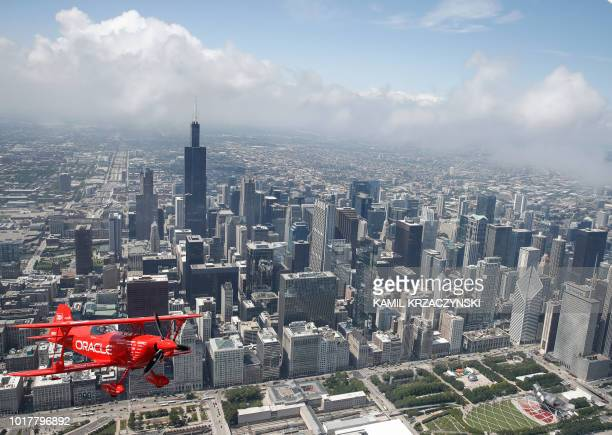 Hall of Fame Air Show Performer Sean D Tucker flies his Oracle Challenger III aircraft over downtown Chicago as he prepares for the 60th annual...