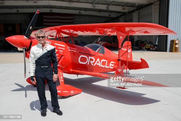 Hall of Fame Air Show Performer Sean D Tucker stands in front of his Oracle Challenger III aircraft after practice round before the 60th annual...