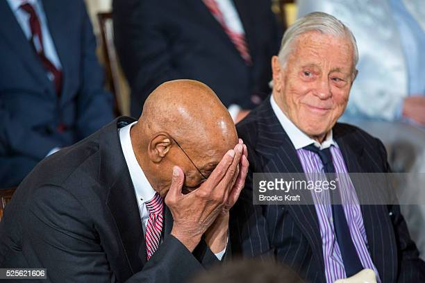Hall of Fame baseball player Ernie Banks jokes with Ben Bradlee former Executive Editor of the Washington Post before US President Barack Obama...