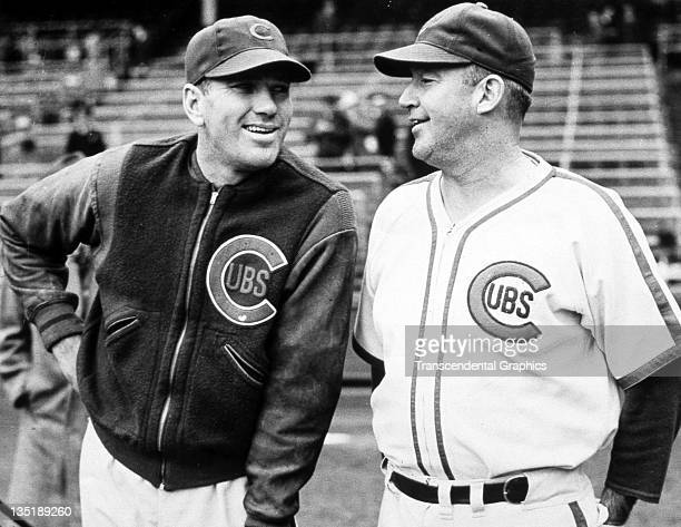Hall of Fame baseball players Dizzy Dean left and Gabby Hartnett share a joke before a game at Wrigley Field in Chicago Illinois in 1938