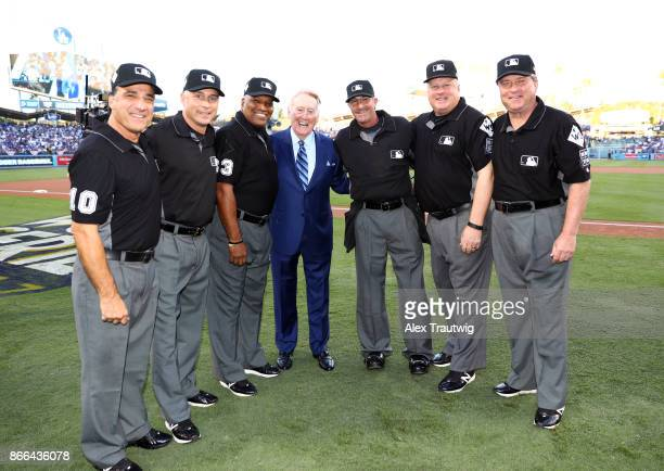 Hall of Fame broadcaster Vin Scully poses for a photo with the umpires before Game 2 of the 2017 World Series between the Houston Astros and the Los...