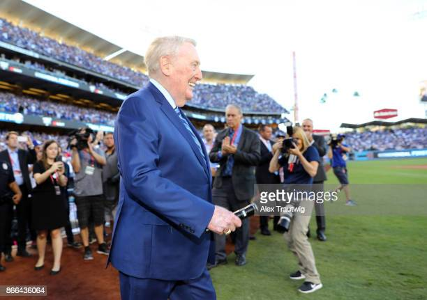 Hall of Fame broadcaster Vin Scully walks onto the field before Game 2 of the 2017 World Series between the Houston Astros and the Los Angeles...
