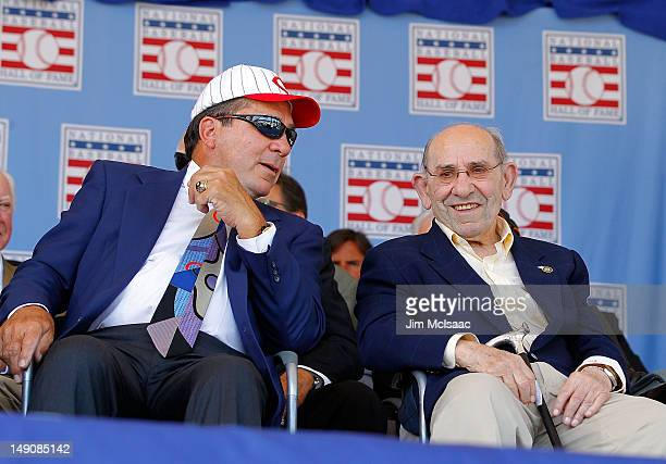 Hall of Fame catchers Yogi Berra and Johnny Bench have a laugh at Clark Sports Center during the Baseball Hall of Fame induction ceremony on July 22...
