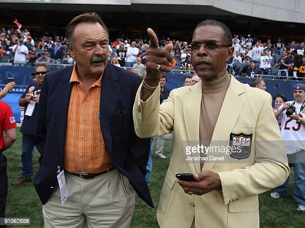 Hall of Fame Chicago Bears Dick Butkus and Gale Sayers chat on the sidelines before a game between the Bears and the Pittsburgh Steelers on September...