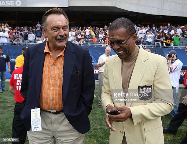 Hall of Fame Chicago Bears Dick Butkus and Gale Sayers share a laugh on the sidelines before a game between the Bears and the Pittsburgh Steelers on...