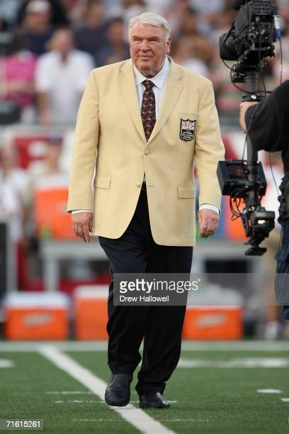 Hall of fame coach and announcer John Madden walks onto the field on August 6 2006 in the AFCNFC Pro Football Hall of Fame Game at Fawcett Stadium in...