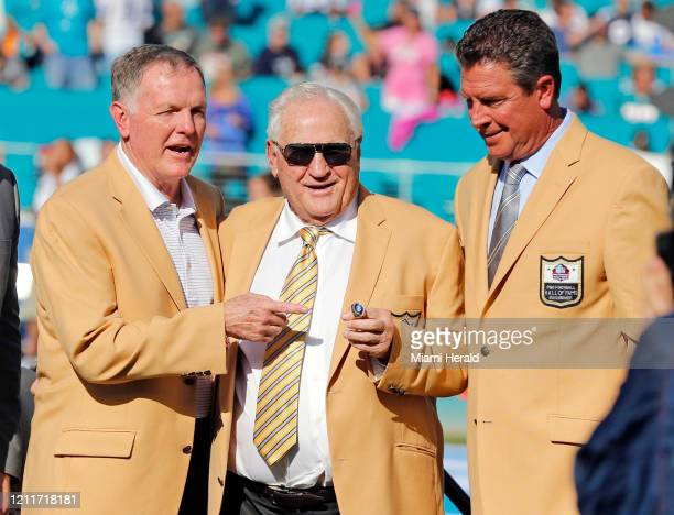Hall of Fame coach Don Shula is presented with a new Hall of Fame ring at halftime while flanked by fellow Dolphin Hall of Famers Bob Griese left and...