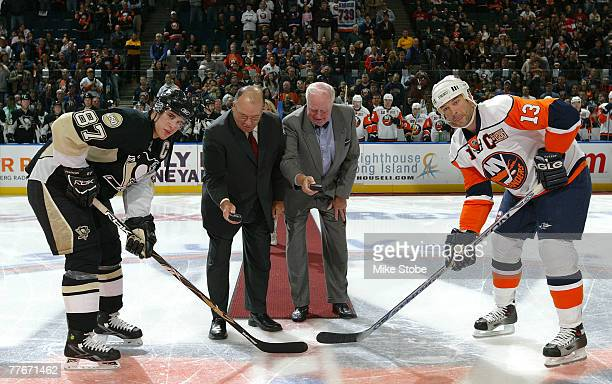 Hall of Fame coach Scotty Bowmen former Islander General Manager of the New York Islanders Bill Torrey Bill Guerin of the New York Islanders and...