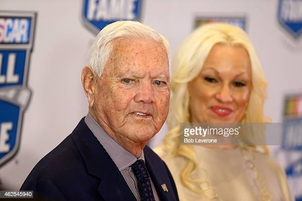 Hall of Fame driver Junior Johnson makes his way into the NASCAR Hall of Fame Induction Ceremony with wife Lisa at the NASCAR Hall of Fame on January...