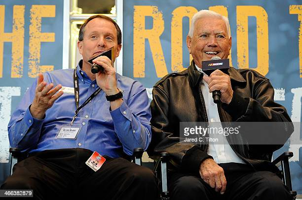 Hall of Fame Executive Director Winston Kelley and NASCAR Hall of Famer Junior Johnson speak on stage during NASCAR Hall of Fame Fan Appreciation Day...