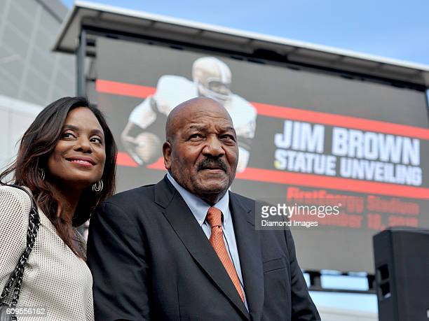 Hall of Fame fullback Jim Brown poses with his wife Monique during the unveiling of his statue outside FirstEnergy Stadium prior to game the...