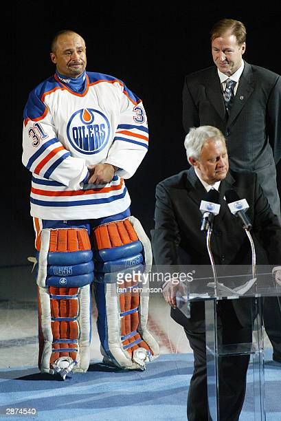 Hall of Fame goaltender Grant Fuhr stands next to former teammate and current Executive Vice President and General Manager of the Edmonton Oilers...