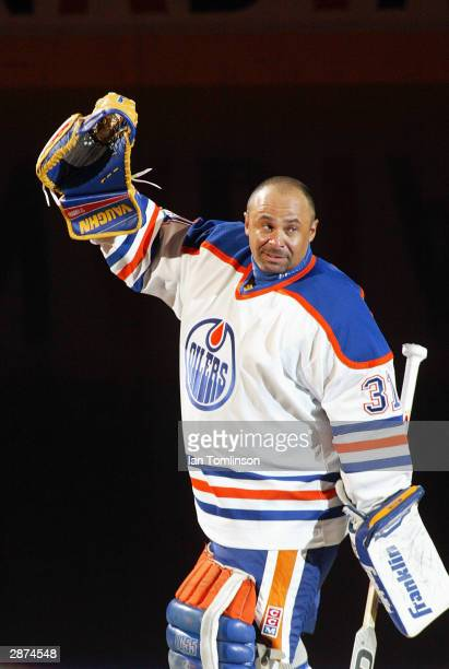 Hall of Fame goaltender Grant Fuhr waves to the crowd of 16839 after the ceremony to retire his number 31 by the Edmonton Oilers before the game...