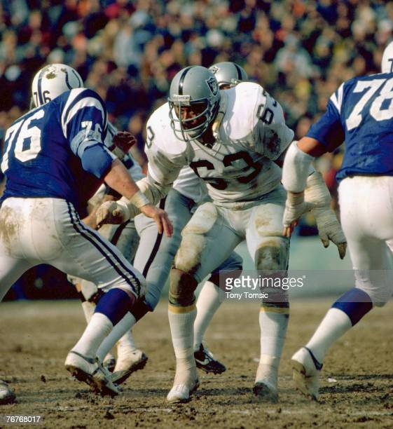 Hall of Fame guard Gene Upshaw of the Oakland Raiders prepares to block Baltimore defensive tackle Joe Ehrmann during the Raiders 3731 overtime...