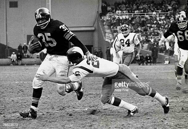 Hall of Fame halfback John Henry Johnson of the Pittsburgh Steelers runs upfield as fellow hall of famer Paul Krause attempts to tackle in a 14 to 7...
