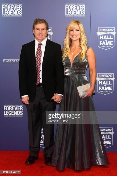 Hall of Fame inductee Bobby Labonte and his wife Kristin pose on the red carpet prior to the 2020 NASCAR Hall of Fame Induction Ceremony at Charlotte...