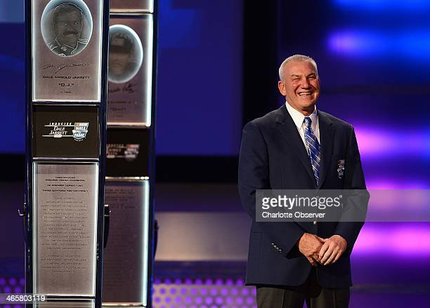 Hall of Fame inductee Dale Jarrett smiles as he listens to country music singer Blake Shelton's comments during the Hall of Fame induction ceremony...