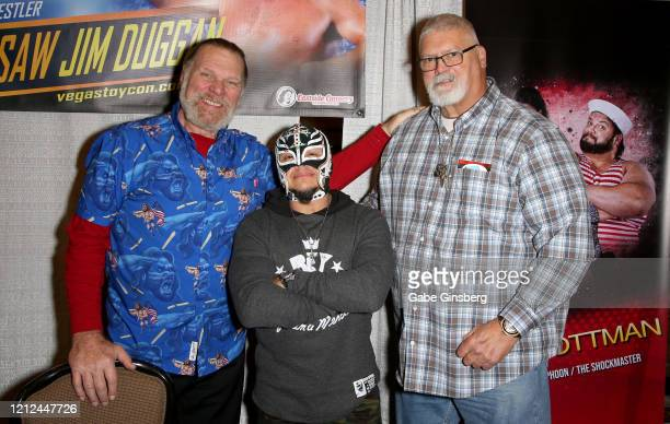 WWE Hall of Fame inductee Hacksaw Jim Duggan professional wrestler Rey Mysterio Jr and former professional wrestler Fred Ottman attend ToyCon 2020 at...