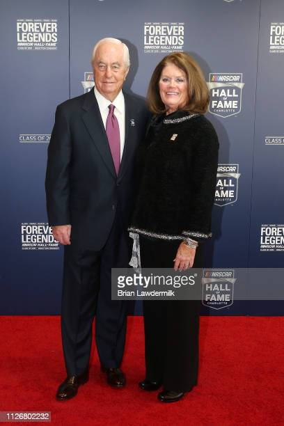 Hall of Fame Inductee Roger Penske poses for a photo with his wife Kathy during the 2019 NASCAR Hall of Fame Induction Ceremony at the Charlotte...