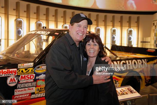 Hall of Fame inductee Ron Hornaday Jr hugs his wife Lindy in front of his hall of Fame exhibit at NASCAR Hall of Fame on January 20 2018 in Charlotte...