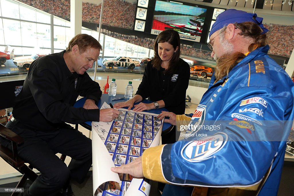 Hall of Fame inductee, Rusty Wallace, signs autographs for fans during the NASCAR Hall of Fame Inductee Marker Unveiling at the NASCAR Hall of Fame on February 10, 2013 in Charlotte, North Carolina.