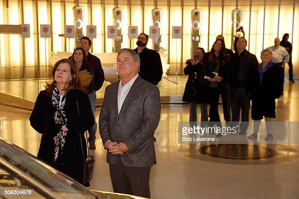 Hall of Fame inductee Terry Labonte right stands with his wife Kim and views his display in the Hall of Honor with close family members January 22 a...