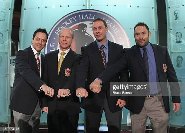 2011 Hall of Fame inductees Doug Gilmour Mark Howe Joe Nieuwendyk and Ed Belfour show off their Hall of Fame rings during a photo opportunity at the...