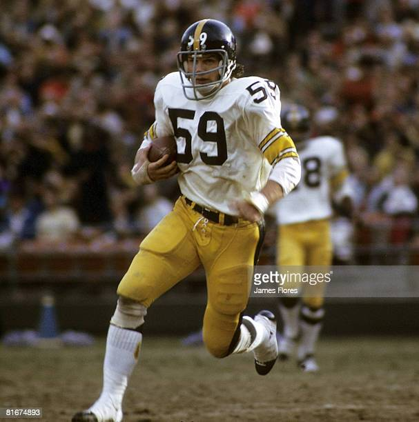Hall of Fame linebacker Jack Ham of the Pittsburgh Steelers runs downfield with the football after making an interception during the Steelers 242...