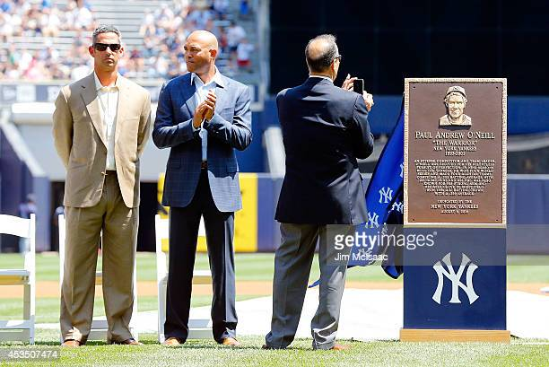 Hall of Fame manager Joe Torre takes a photograph of former Yankee Paul O'Neill's monument park plaque before a game against the Cleveland Indians as...