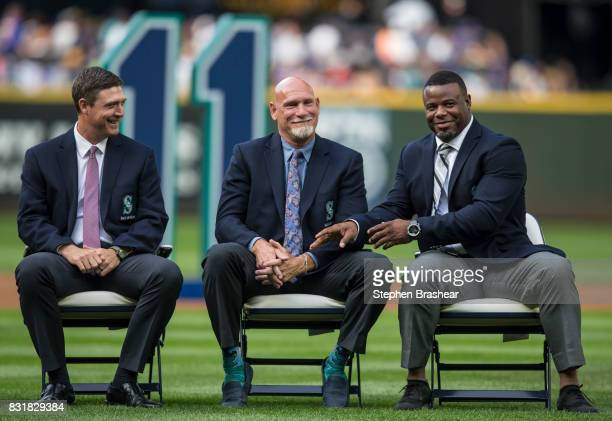 Hall of Fame member and former Seattle Mariner Ken Griffey Jr right jokes around while trying to grab the hand of former Mariner Jay Buhner during a...