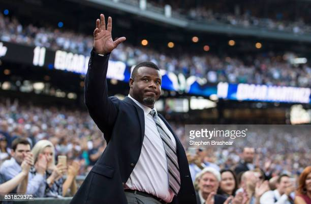 Hall of Fame member and former Seattle Mariner Ken Griffey Jr waves to the crowd as he is introduced during a ceremony to retire the number of Edgar...