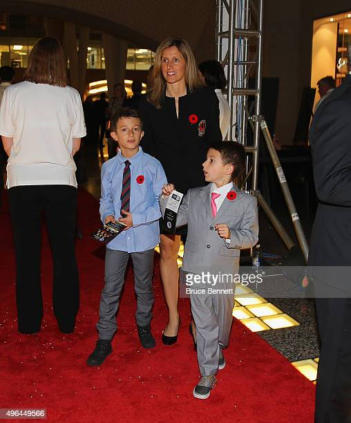 Hall of Fame member Cammi Granato and her sons walk the red carpet prior to the 2015 Hockey Hall of Fame Induction Ceremony at Brookfield Place on...