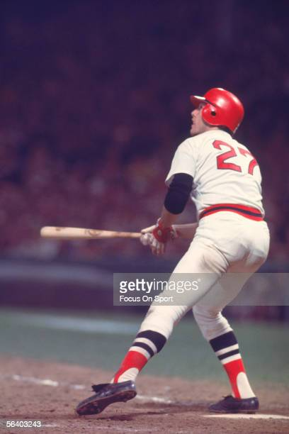 Hall of Fame member Carlton Fisk of the Boston Red Sox hits a home run off the foul pole in the 12th inning of game six against the Cincinnati Reds...